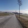 Abfahrt nach Oberwil, vor dem Alpenkamm im Hintergrund