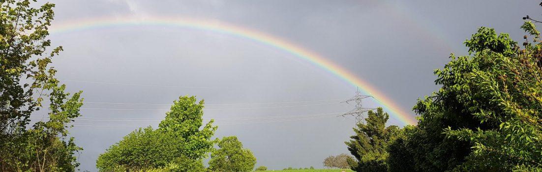 Regenbogen über Scherz
